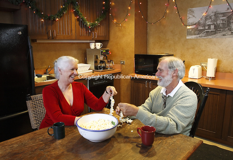 WESTPORT, CT. 10 September 2008--TheatreCT-- Anne Keefe, co-artistic director of the Westport Country Playhouse, and her husband, playwright and novelist David Wiltse said stringing popcorn is a tradition at their home. <br /> Photo by Jamison C. Bazinet