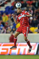 C.J. Brown (2) of the Chicago Fire heads the ball during the second half of a Major League Soccer match between the New York Red Bulls and the Chicago Fire at Red Bull Arena in Harrison, NJ, on March 27, 2010. The Red Bulls defeated the Fire 1-0.