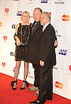 LOS ANGELES, CA. - January 29: Neil Young (C) wife Pegi Morton (L) and Neil Portnow, President of the National Academy of Recording Arts and Sciences arrive at the 2010 MusiCares Person Of The Year Tribute To Neil Young at the Los Angeles Convention Center on January 29, 2010 in Los Angeles, California.