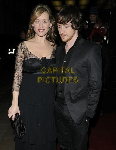 ANNE MARIE DUFF & JAMES McAVOY .The UK Premiere of 'The Last Station' at The Curzon Mayfair Cinema, London, England..January 26th 2010.half length black jacket dress lace clutch bag married husband wife beard facial hair maxi suit hand in pocket looking down.CAP/CAN.©Can Nguyen/Capital Pictures.