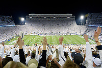 Fans cheer in the stands as Saquon Barkley scores on a first quarter touchdown run during the whole stadium White Out that was an all-time Penn State attendance record with 110,823. The Penn State Nittany Lions defeated the Michigan Wolverines 42-13 on October 21, 2017 at Beaver Stadium in State College, PA.