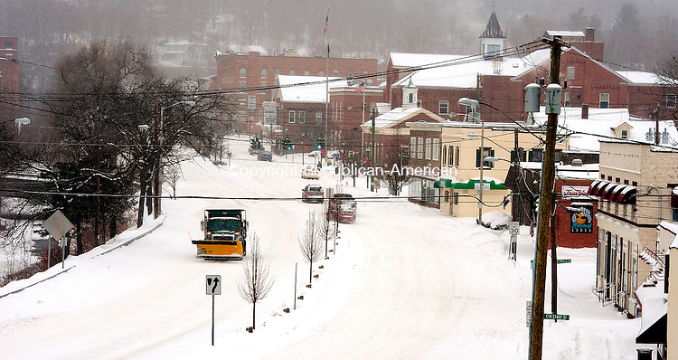 WINSTED,  CT-020215JS00-  Heavy snow blanketed downtown Winsted on Monday. Nearly a foot of snow fell in some parts of the area with colder temperatures coming in. <br /> Jim Shannon Republican-American