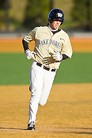 Grant Shambley #43 of the Wake Forest Demon Deacons rounds second base against the Georgetown Hoyas at Wake Forest Baseball Park on February 26, 2012 in Winston-Salem, North Carolina.  The Demon Deacons defeated the Hoyas 5-2.  (Brian Westerholt / Four Seam Images)