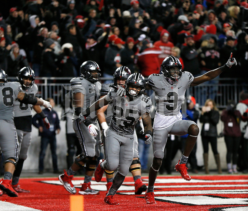 Ohio State Buckeyes wide receiver Binjimen Victor (9) and Ohio State Buckeyes running back Mike Weber (25) celebrate after Ohio State Buckeyes tight end Marcus Baugh (85) made the game-winning catch during the fourth quarter of the NCAA football game between the Ohio State Buckeyes and the Penn State Nittany Lions at Ohio Stadium on Saturday, October 28, 2017. [Jonathan Quilter/Dispatch]