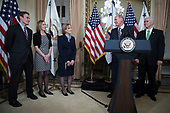 Director of National Intelligence Dan Coats (2-R), with his wife Marsha Coats (C), family members and United States Vice President Mike Pence (R), delivers remarks during a swearing in ceremony in the US Capitol in Washington, DC, USA, 16 March 2017.<br /> Credit: Shawn Thew / Pool via CNP