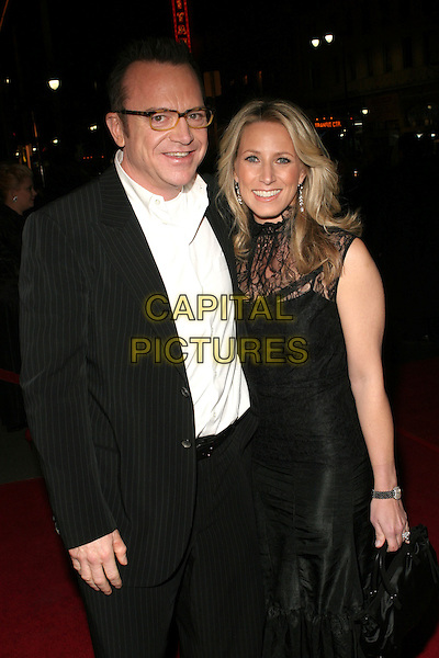 "TOM  & SHELBY ARNOLD.""The Kid & I"" Los Angeles Premiere - Arrivals held at Grauman's Chinese Theatre.  Hollywood, California..USA, United States..28th November 2005.Ref:ADM/ZL.half length with together married wife husband spectacles glasses smiling.www.capitalpictures.com.sales@capitalpictures.com.© Capital Pictures."