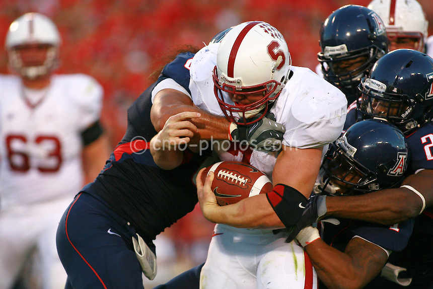 Oct 17, 2009; Tucson, AZ, USA; Stanford running back Toby Gerhart (7) is gang-tackled by the Arizona Wildcats defense during the 2nd quarter of a game at Arizona Stadium.