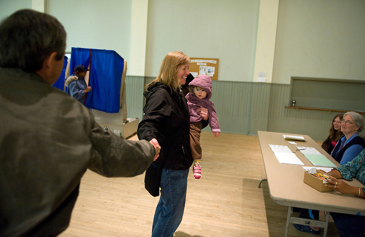 Rep. Joe Sestak, D-Pa., talks with Jennifer Hill and her daughter Zoe, 18 months inside of the Summit Hill Presbyterian Church which acted as the polling place in the Mt. Airy neighborhood of Philadelphia on the day of Senate democratic primary, May 18, 2010.