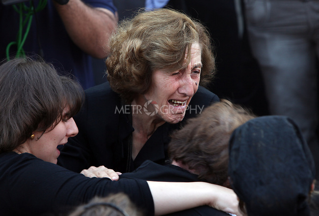BAGHDAD, IRAQ: A grieving woman weeps during the funeral for the victims who died during the siege of the Our Lady of Salvation Catholic Church in Baghdad...At least 52 people were killed when Iraqi troops raided the Our Lady of Salvation Catholic Church where gunmen were holding hostages on Sunday...Photo by Ceerwan Aziz/Metrography