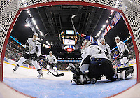 The puck sails past San Antonio Rampage goaltender Rob Madore for a Rochester Americans goal during the first period of an AHL hockey game, Saturday, Jan. 18, 2014, in San Antonio (Darren Abate/AHL)