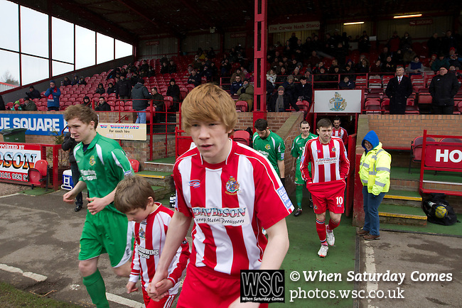 Altrincham 2 Worcester City 0, 23/03/2013. Moss Lane, Blue Square Bet North. The two teams walking onto the pitch before the Blue Square Bet North fixture between Altrincham (in red) and Worcester City at Moss Lane, Altrincham. The home team won the match 2-0 watched by 777 spectators on a day when most non-League football in England was cancelled due to adverse weather. Altrincham were historically one of the major English non-League teams but have never been promoted to the Football League. Photo by Colin McPherson.