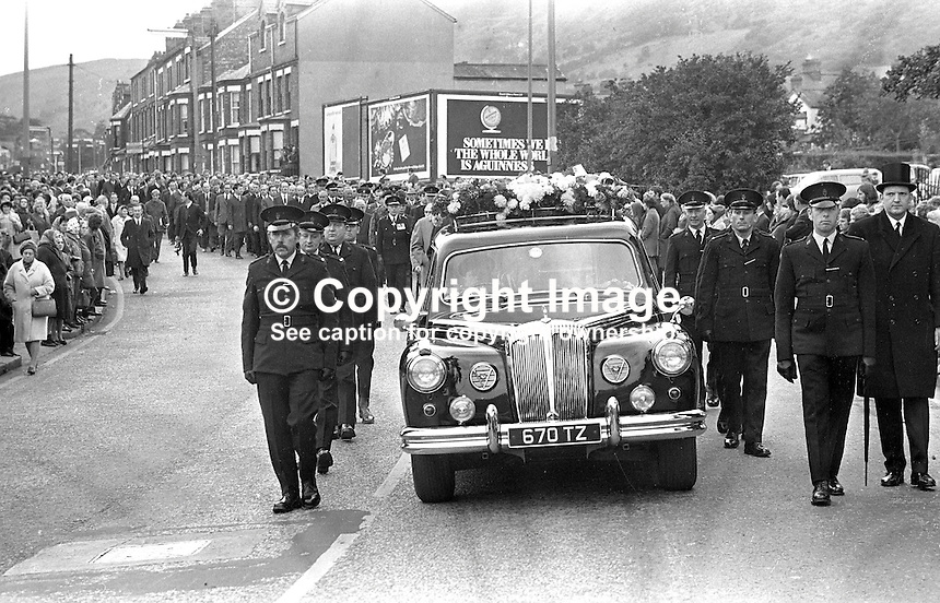 Thousands line the route of the funeral procession of Constable Cecil Cunningham who was shot by the IRA from a passing car while sitting in a stationary Royal Ulster Constabulary (RUC) car at the junction of Woodvale Road and Twaddell Avenue, Belfast. 420/71, 197110180420c..Copyright Image from Victor Patterson, 54 Dorchester Park, Belfast, UK, BT9 6RJ..Tel: +44 28 9066 1296.Mob: +44 7802 353836.Voicemail +44 20 8816 7153.Skype: victorpattersonbelfast.Email: victorpatterson@mac.com.Email: victorpatterson@ireland.com (back-up)..IMPORTANT: If you wish to use this image or any other of my images please go to www.victorpatterson.com and click on the Terms & Conditions. Then contact me by email or phone with the reference number(s) of the image(s) concerned.