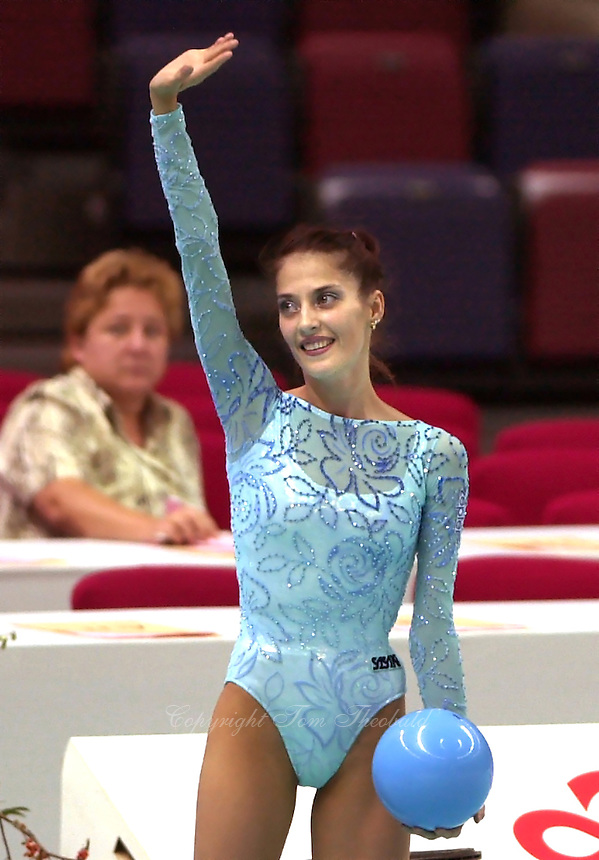 03 OCTOBER 1999 - OSAKA, JAPAN:  Elena Vitrichenko of Ukraine waves to fans after performing with ball at the 1999 World Championships in Osaka, Japan.  Elena won gold in this Event Final and took 5th in the All-Around.