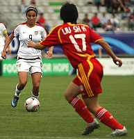 Chile, Temuco: Usa forward Gina Dimartino (L) goes for the ball along with Liu Shukun, Chine team, during the final match on the group, Fifa U-20 Womens World Cup the at German Becker stadium in Temuco , on November 26 2008. Photo by Grosnia/ISIphotos.com
