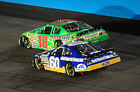 Apr 11, 2008; Avondale, AZ, USA; NASCAR Nationwide Series driver Kyle Busch (18) passes Carl Edwards (60) for the lead during the Bashas Supermarkets 200 at the Phoenix International Raceway. Mandatory Credit: Mark J. Rebilas-