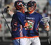 Jack Orlando #19 of Manhasset, right, celebrates with goalie Grant Petracca #40 after their team's 7-4 win over host Garden City High School in 133rd Woodstick Classic on Saturday, April 28, 2018.