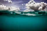 INDONESIA, Mentawai Islands, Kandui Surf Resort, half underwater and half sky and clouds, Indian Ocean