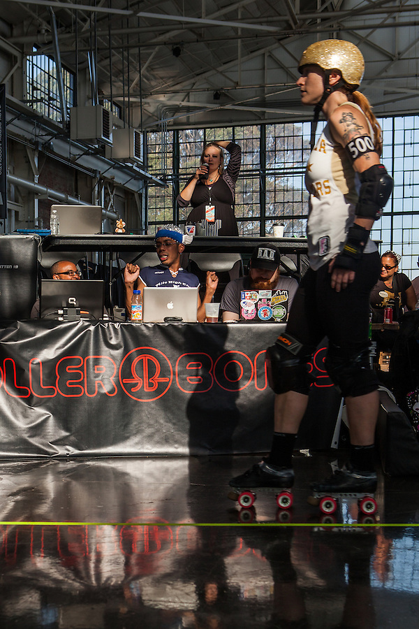 """The Rose City Rollers Wheels of Justice all-star team and the Bay Area Derby Girls wait during a """"sun delay"""" at the semi-finals of the 2012 WFTDA Western Regionals. Bay Area eventually won and advanced to the national tournament."""