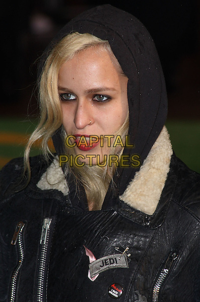 ALICE DELLAL.World Premiere of 'Alice In Wonderland' at the Odeon, Leicester Square, London, England..February 25th, 2010.headshot portrait black leather hoodie sheepskin jedi mouth open red lipstick .CAP/JIL.©Jill Mayhew/Capital Pictures