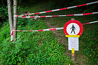 Switzerland. Canton Graubunden. Bregaglia valley. Bondo. A second massive landslide hit Bondo while the remote village was still recovering from a huge landslide caused by a giant rockslide swept down from Piz Cengalo on August 23, 2017. The mountains's paths are closed to hikers. Prohibition No Pedestrian Sign. Prohibited signs silhouette of walking man in a crossed circle isolated on white background. 26.08.2017 © 2017 Didier Ruef