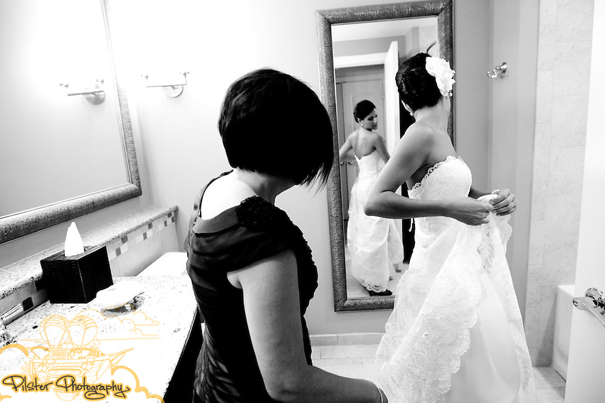 Katie Olsen get's ready on Sunday, May 30, 2010, at the Sandpearl Resort in Clearwater Beach, Florida. The Clearwater Beach, Florida wedding of Katie Olsen and Justin Compton started with Katie getting ready at the Residence Inn Suites and Justin getting ready at a beach house, then they did a first look at the Sandpearl Resort before going to the  Carlouel Yacht Club for the ceremony and reception.  (Chad Pilster, PilsterPhotography.net)