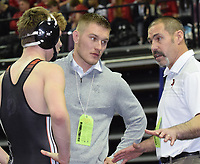 RICK PECK/SPECIAL TO MCDONALD COUNTY PRESS<br /> McDonald County wrestling coach Josh Factor (right) talks strategy with Oscar Ortiz while son and assistant coach Cody Factor looks on during a break in Ortiz's semifinal win over Josh Fennell of Rolla at the Missouri Class 3 Wrestling Championships held Feb. 14-16 in Columbia.
