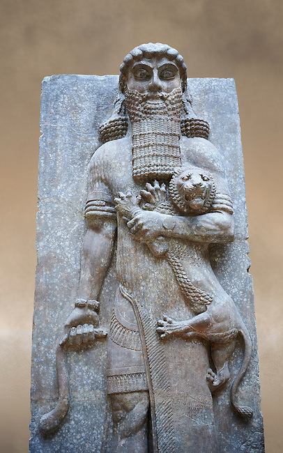 Stone relief sculptured panel of a Hero holding a lion. From the facade of the throne room,  Inv AO 19862 from Dur Sharrukin the palace of Assyrian king Sargon II at Khorsabad, 713-706 BC.  Louvre Museum Room 4 , Paris