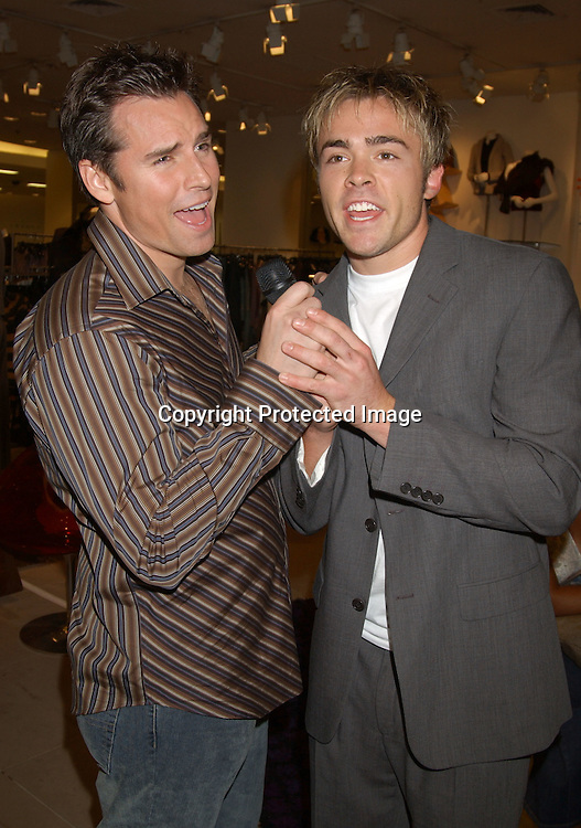 ..John-Paul Lavoisier and Dan Gauthier of One Life to Live  singing                              ..at the Saks Fifth Avenue's Key to the Cure Celebrity Launch on September 17, 2003 in New York City. ..Photo By Robin Platzer, Twin Images