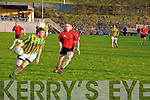 Mike Jim Fitzgerald with ball for Lispole being closely watched by Joe McGillicuddy of Glenbeigh