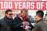 U.S. men's head coach Jurgen Klinsmann signs autographs for fans during the centennial celebration of U. S. Soccer at Times Square in New York, NY, on April 04, 2013.