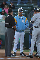 Myrtle Beach Pelicans manager Jason Wood #40 meeting at the plate  before a game against the Potomac Nationals at Tickerreturn.com Field at Pelicans Ballpark on April 12, 2012 in Myrtle Beach, South Carolina. Myrtle Beach defeated Potomac by the score of 1-0. (Robert Gurganus/Four Seam Images)