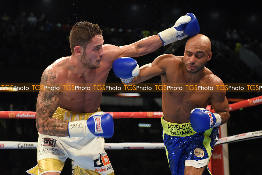 Ben Hall (white/gold shorts) defeats Kris Agyei-Dua to win the Southern Area Super-Welterweight Title during a Boxing show at the Copper Box Arena, promoted by Matchroom Sports