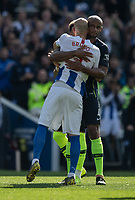 Manchester City's Vincent Kompany (right) hugs Brighton & Hove Albion's Bruno as Bruno leaves the pitch for the last time and retires<br /> <br /> Photographer David Horton/CameraSport<br /> <br /> The Premier League - Brighton and Hove Albion v Manchester City - Sunday 12th May 2019 - The Amex Stadium - Brighton<br /> <br /> World Copyright © 2019 CameraSport. All rights reserved. 43 Linden Ave. Countesthorpe. Leicester. England. LE8 5PG - Tel: +44 (0) 116 277 4147 - admin@camerasport.com - www.camerasport.com