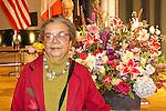Award winner, Marian Wright delman poses nesxt to flowers at the John Jay Justice Award ceremony, April 5 2011.