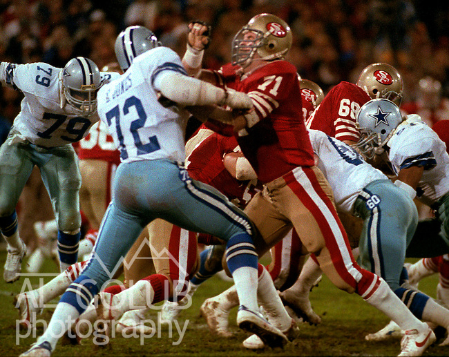 """San Francisco 49ers vs. Dallas Cowboys at Candlestick Park Monday, December 19, 1983..49ers beat the Cowboys  42-17.Dallas Cowboys Defensive End Ed """"Too Tall"""" Jones (72) and 49er Tackle Keith Fahnhorst fight it out..."""