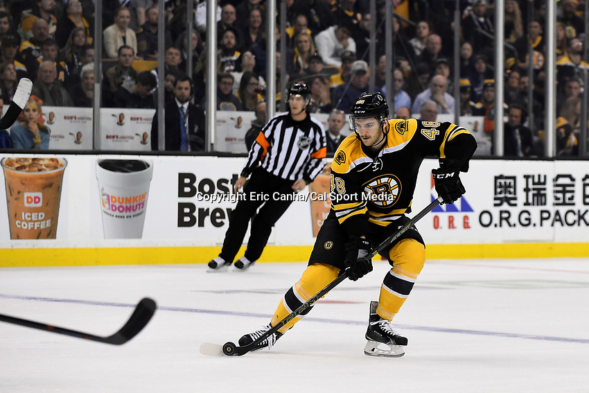 Saturday, November 21, 2015: Boston Bruins defenseman Colin Miller (48) plays the puck at the blue line during the National Hockey League game between the Toronto Maple Leafs and the Boston Bruins held at TD Garden, in Boston, Massachusetts. The Bruins defeat the Maple Leafs 2-0 in regulation time. Eric Canha/CSM