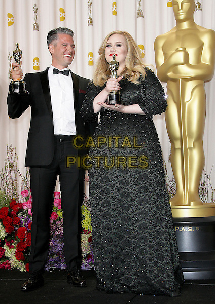 Paul Epworth, Adele (Adele Laurie Blue Adkins)  .85th Annual Academy Awards held at the Dolby Theatre at Hollywood & Highland Center, Hollywood, California, USA..February 24th, 2013.pressroom oscars full length trophies winners black dress tuxedo white shirt glasses award trophy winner  beads beaded .CAP/ADM.©AdMedia/Capital Pictures.