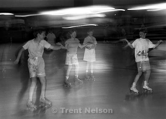 &quot;Skate like an Egyptian.&quot; Kids roller-skating at Classic Skating Rink.<br />