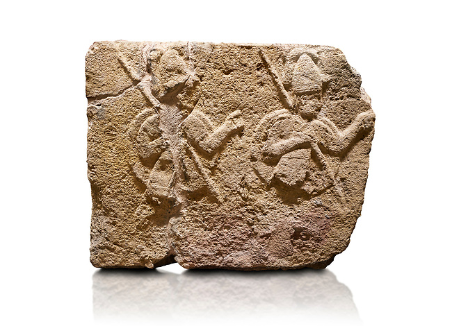 Hittite relief sculpted orthostat stone panel of Long Wall Limestone, Karkamıs, (Kargamıs), Carchemish (Karkemish), 900-700 B.C. . Anatolian Civilisations Museum, Ankara, Turkey.<br /> <br /> Two helmeted soldiers in short skirt carry shield on their backs and spear in their hands.<br /> <br /> On a White Background.