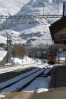 Train transporting cars approaching Realp after travelling through the Furkapass in the alps, Realp, Switzerland.