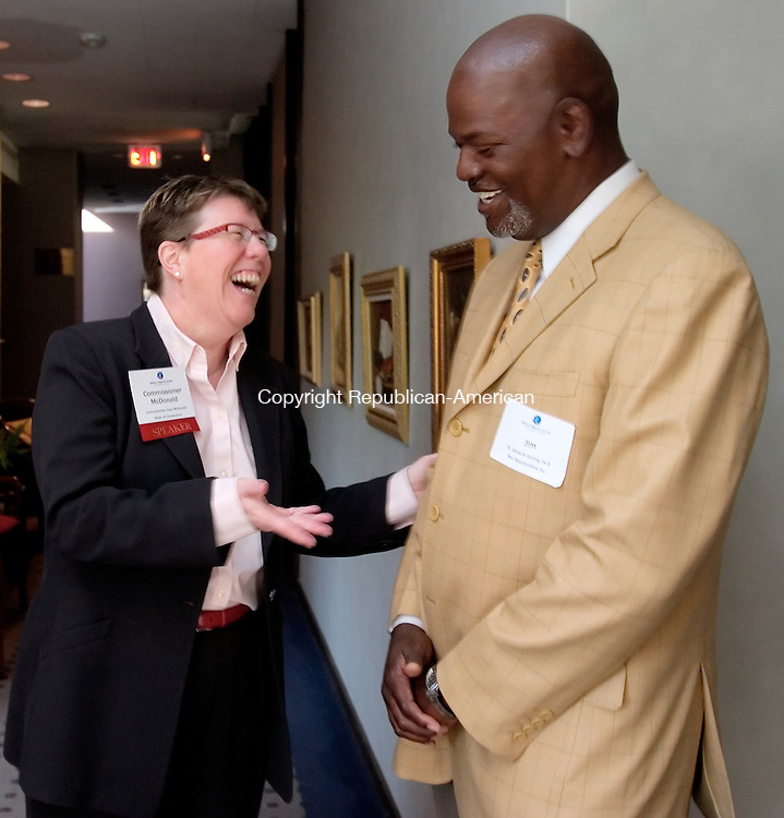 WATERBURY, CT. 25 April 2008-042508SV02--Joan McDonald, Commissioner of Department of Economic and Community Development, talks with Dr. James H. Gatling of New Opportunities Inc. during the Economic Growth breakfast of the Greater Waterbury Chamber at the Waterbury Club in Waterbury Friday.  Steven Valenti Republican-American