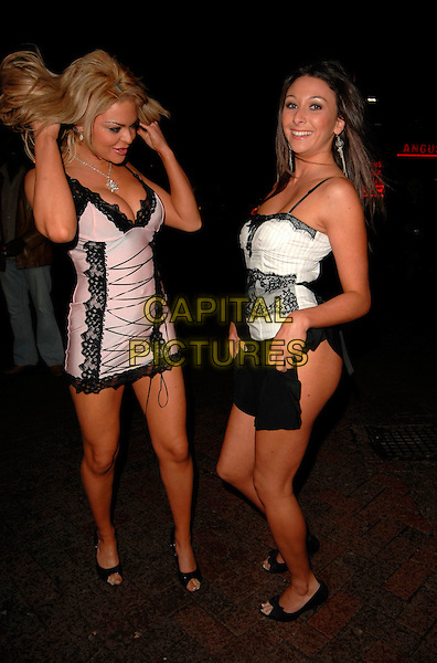 LISA MARIE (?) & AALIYAH JOHNSON.The Miss Sunday Sport 2007 Final, View Lounge, Leicester Square, London, UK..February 28th, 2007.full length pink lace dress lingerie skirt white black hair pinstripe .CAP/CAN.©Can Nguyen/Capital Pictures