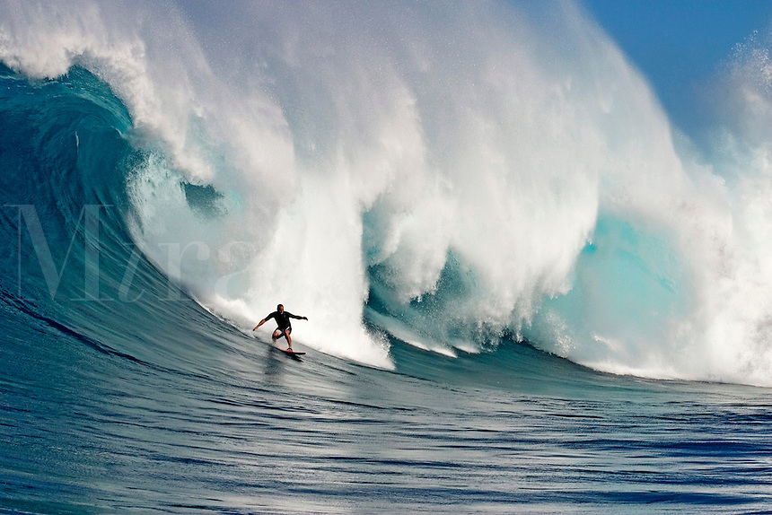 A tow-in surfer drops to the curl of Hawaii's big surf at Peahi (Jaws) off Maui.<br />