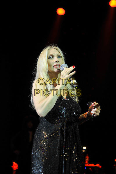 Singer / songwriter Lynsey De Paul has died at the age 64 following suspected brain haemorrhage. She represented the UK in the 1977 Eurovision Song Contest and was best known for her hits Sugar Me and Won't Somebody Dance With Me.<br /> STOCK PHOTO: Lynsey de Paul<br /> performing for Marc Bolan's 35th anniversary concert in aid of the PRS for Music Members Benevolent Fund, Shepherd's Bush Empire, London, England. <br /> 15th September 2012<br /> on stage in concert live gig performance performing music half length singing black dress <br /> CAP/MAR<br /> &copy; Martin Harris/Capital Pictures