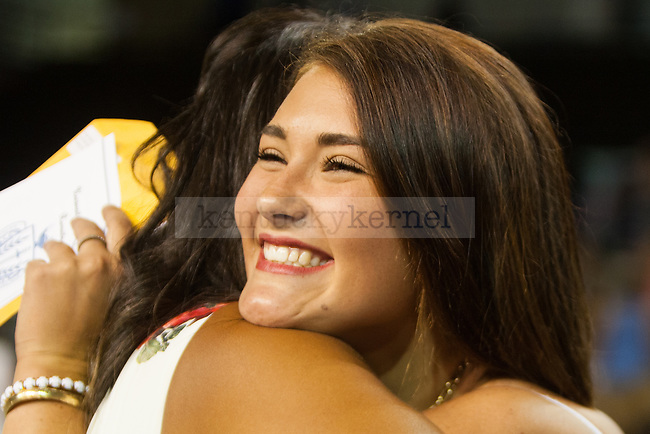 Jocelyn King, right, hugs Mila Hudson after King receives a bid from Hudson's sorority, Alpha Delta Pi, during sorority bid day in Lexington, Ky. on Friday, August 21, 2015. Photo by Adam Pennavaria | Staff