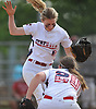 Jessica Budrewicz #9, MacArthur pitcher, left, celebrates with teammate Lisa Fabig #20 after pitching a scoreless frame in Game 2 of the best-of-three Nassau County varsity softball Class A final against Island Trees at Mitchel Athletic Complex on Wednesday, May 24, 2017. MacArthur won the game 2-0 and the series two games to none.