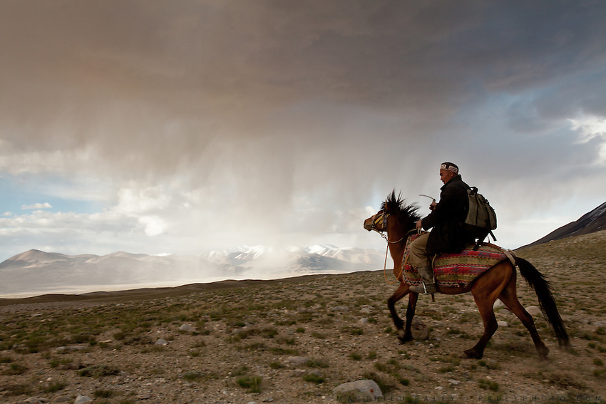Daryo Boi returns home on horseback under a stormy sky...Daily life at the Khan (chief) autumn camp (called Teramo Jai - place of Autumn), beside the Aksu river...Trekking through the high altitude plateau of the Little Pamir mountains (average 4200 meters) , where the Afghan Kyrgyz community live all year, on the borders of China, Tajikistan and Pakistan.