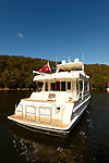 Motor Yacht Outer Reef 63.The Taiwanese-built Outer Reef 63.Outer Reef constructed the 63--currently the smallest in a fleet of motoryachts ranging to 115 feet--with a traditional hand-laid FRP hull that's solid fiberglass below the waterline and cored with PVC sandwich above. This combination helps provide strength while keeping displacement at a moderate 73,000 pounds