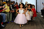 Child models walk runway in outfits from the Belle Threads collection, during the KidFash Magazine runway show in Brooklyn, New York on Nov 4, 2017.