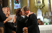 Boston, MA - August 29, 2009 -- U.S. Senator Edward Kennedy's widow Vicki Reggie Kennedy (C) hugs his son Edward Kennedy Jr. as the Senator's daughter Kara Kennedy Allen (L) applauds after he offered remembrances of his father. during funeral services for U.S. Senator Edward Kennedy at the Basilica of Our Lady of  Perpetual Help in Boston, Massachusetts August 29, 2009.  Senator Kennedy died late Tuesday after a battle with cancer..Credit: Brian Snyder- Pool via CNP